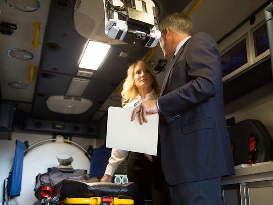 A truck engineer takes Phoenix Fire Chief Kara Kalkbrenner