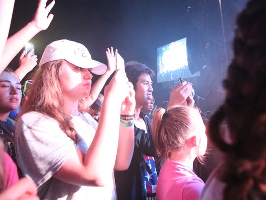 A large number of students crowded the stage Saturday