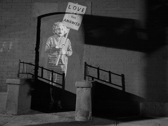 A wheat paste and poster artist leaves a late-night