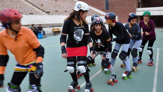 Skaters perform a drill at a roller derby practice in Cairo on Sept. 9.