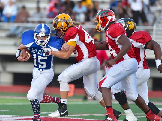 The East's Greg Corn of Madeira is tackled by the West's Eric Allgeier of Ross Thursday, June 8th at Kings High School 2017 SWOFCA East/West All-Star Football Game