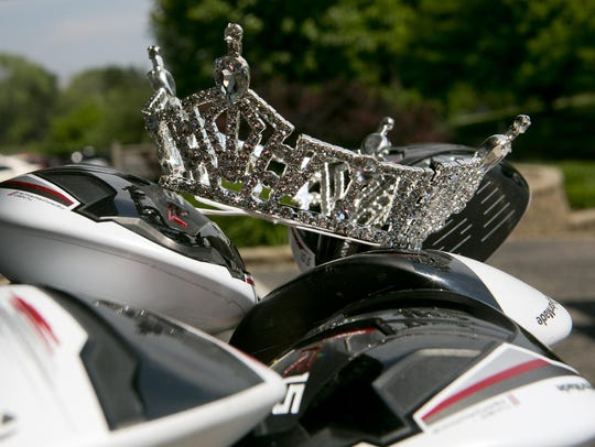 The Miss Wisconsin Rapids Area tiara sits on golf clubs