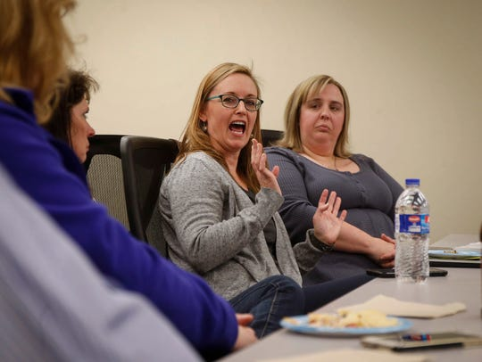 Diane Proffitt, right, of Urbandale, listens as Lynda O'Hara of West Des Moines talks about her son, Richard, who passed away on July 3, 2017 from a heroin overdose.
