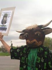 Marijuana advocate Ray Lakers dresses in a bull's head,