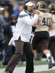 Western Michigan coach P.J. Fleck pumps his fist during the first quarter against the Toledo Rockets at Glass Bowl on Nov. 27, 2015.