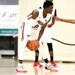 Five-star guard De'Aaron Fox (left) is high on Louisville's 2016 wish list. (2015 NIKE EYBL. SESSION 4. Minneapolis, Minn.)