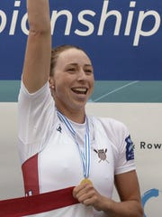 Olivia Coffey celebrates on the podium after her team won the A final in the women's coxless quad in September at the 2015 World Rowing Championships in France.