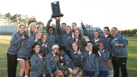 Members of the Brookdale women's soccer team celebrate their victory in the final round of the NJCAA Division III tournament on Sunday.