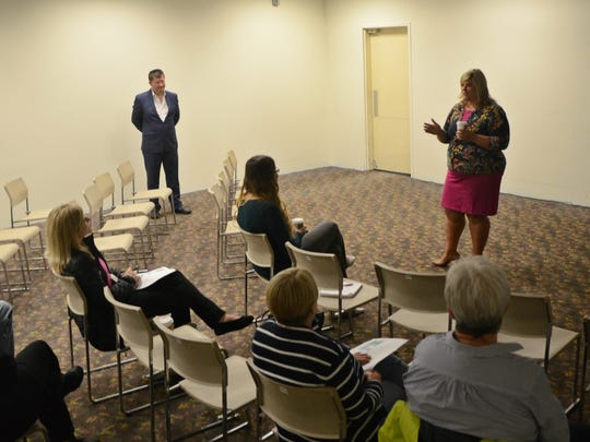 Battle Creek Area Chamber of Commerce President Kara Beer chats with a room of about 10 people Tuesday ahead of a presentation by pop-up retail expert Stephen Brooks.