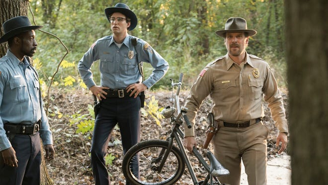 "Rob Morgan, left, John Reynolds and David Harbour portray Hawkins, Ind., police officers in ""Stranger Things."""