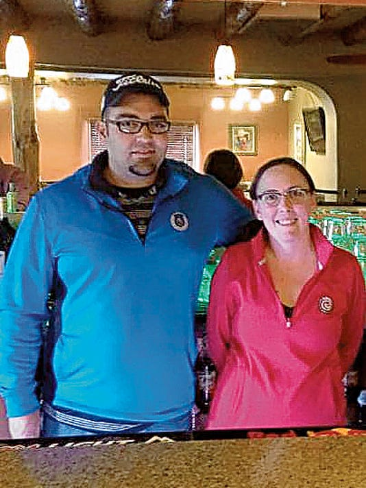 Eric Lowe - Headlight Photo   Chris Ortiz and Amber Wood oversee business activities at the newly renovated Rio Mimbres Country Club. Ortiz manages the restaurant and bar lounge while Wood is the club's bartender.