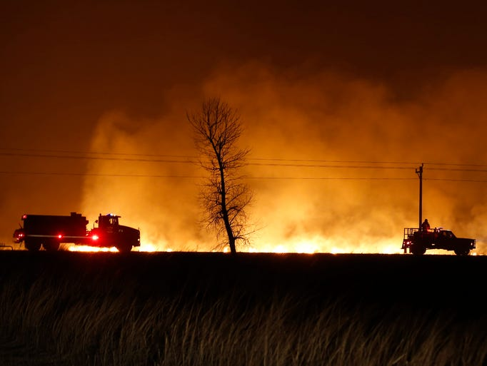 Firefighters from across Kansas and Oklahoma battle