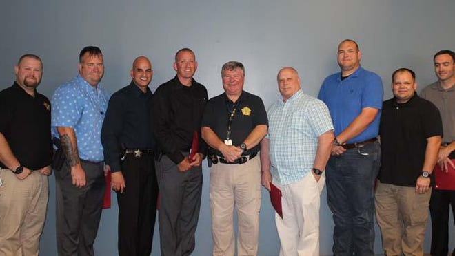 Onslow County Sheriff's Office recently participated in a leadership program provided by Coastal Carolina Community College. The program is a three-week leadership development training program provided by the International Associations of Chief of Police. Pictured are Sgt. T. Schwartz, Sgt. K. Parker, Sgt. R. Henriquez, Sgt. J. Seifert, Sheriff Miller, Cpl. K. Appleyard, Dep. M. Hardison, Sgt. J. Gober and Dep. C. Fisher.