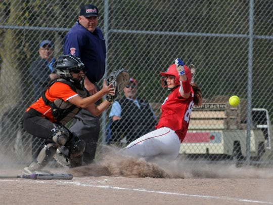 Saints' Molly Likins slides into home Monday, May 9,