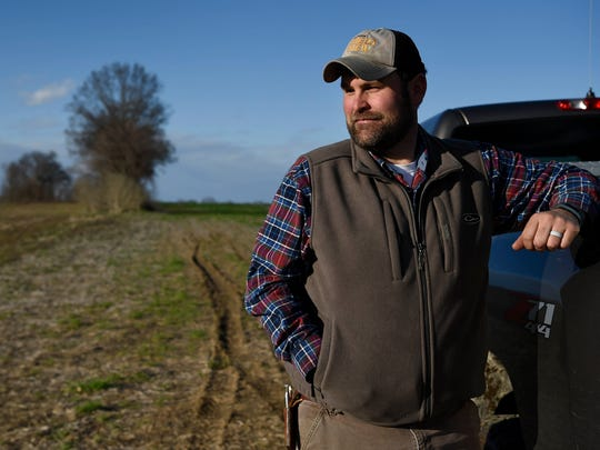 Farmer Todd Littleton stands on his property where he plans to raise chickens for the Tyson plant which is bringing 1,500 jobs to Gibson County in Humboldt, Tenn., Tuesday, March 6, 2018.