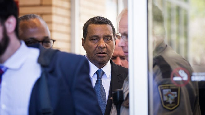 Prince's half-brother Alfred Jackson, center, leaves the Carver County Courthouse in Chaska, Minn., Monday, May 2, 2016. With the approval of most of Prince's siblings, Carver County District Court Judge Kevin Eide confirmed the appointment of Bremer Trust, National Association as special administrator to manage the late musician's assets during a probate hearing. (Leila Navidi/Star Tribune via AP)