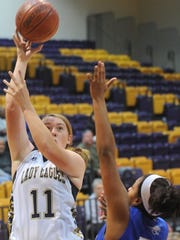 Abilene High's Abigail Zeller (11) shoots over Weatherford's Shakira Reece (33). The Lady Roos beat AHS 60-36 in the third-place game of the Polk-Key City Classic last season at Hardin-Simmons' Mabee Complex.