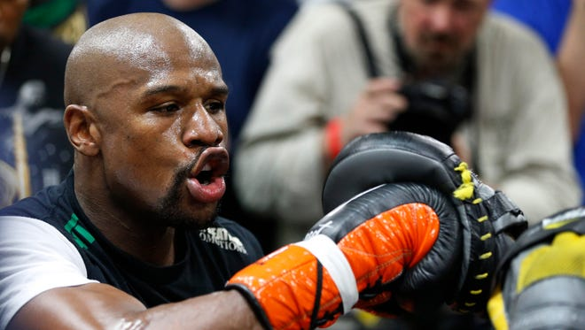 Boxer Floyd Mayweather Jr. works out with his uncle Roger Mayweather on April 14, 2015, in Las Vegas.
