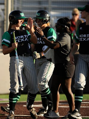 North Texas's Kelli Schkade (9) is congratulated by teammates after hitting a 2-run home run in the top of the fifth inning of the Mean Green's 6-2 loss to Abilene Christian on Wednesday, April 19, 2017, at ACU's Poly Wells Field.