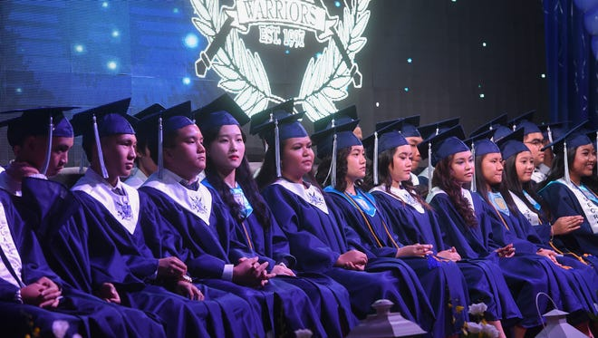 The St. Paul Christian School Class of 2018 graduates during their commencement ceremony at the Leo Palace Resort Guam on May 19, 2018.