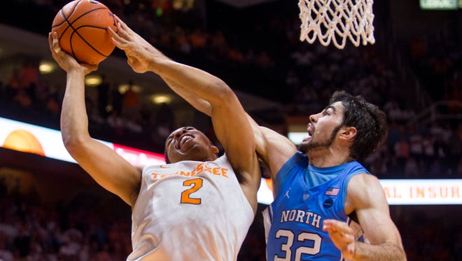 Tennessee forward Grant Williams (2) fights to attempt a shot despite the defense of North Carolina forward Luke Maye (32) on Sunday.