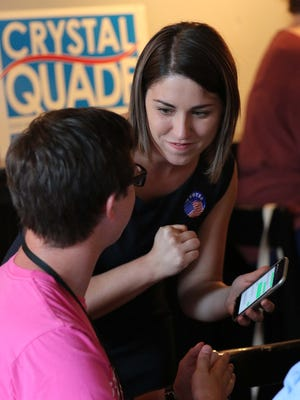 Crystal Quade chats with supporters during a watch party for the 132nd district on Commercial Street in Springfield on Tuesday night.