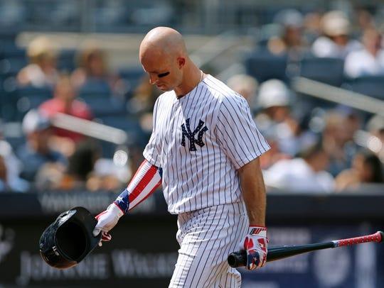 New York Yankees' Brett Gardner returns to the dugout