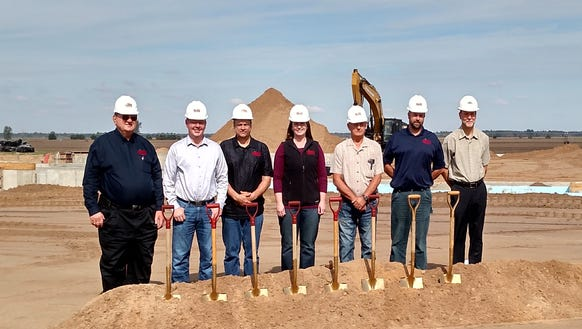 A groundbreaking ceremony for a new farm operations,