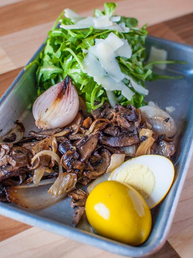 A mushroom salad with shallots and fennel tossed in