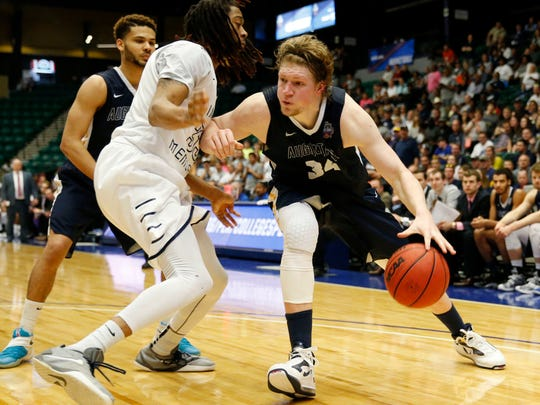 Augustana's Daniel Jansen (34) drives on Lincoln Memorial's Emanuel Terry (33) during the second half of the 2016 Division II National Championship Game at Dr Pepper Arena in Frisco on Saturday, March 26, 2016. Augustana defeated Lincoln Memorial 90-81 to win the championship. (Vernon Bryant/The Dallas Morning News)  -- MANDATORY CREDIT, NO SALES, MAGS OUT, TV OUT, INTERNET USE BY AP MEMBERS ONLY