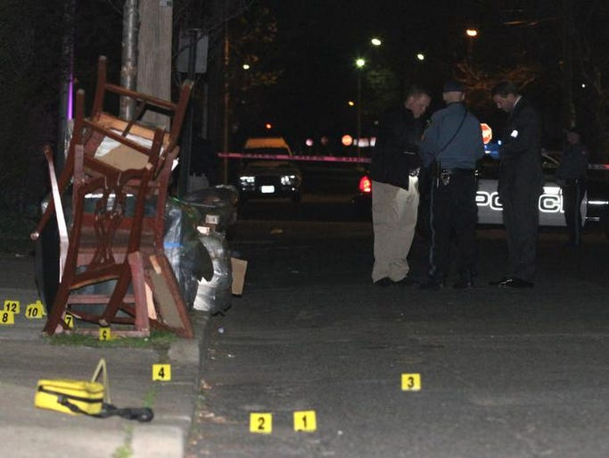 Investigators at the scene of a shooting on Comstock Street in Asbury Park Monday, April 28 2014.