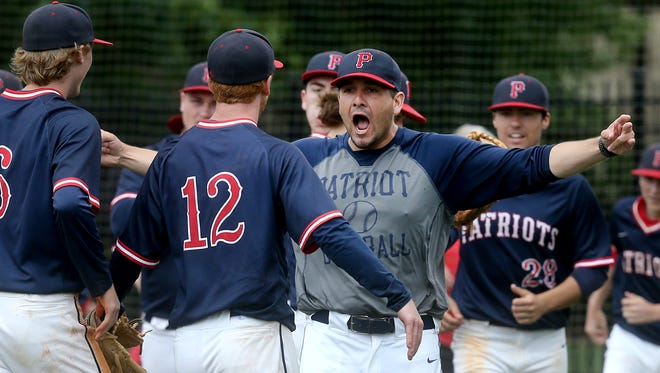 Jefferson County's head coach Zach Reese celebrates with his pitcher Brandon Saylor after beating Stewarts Creek 3-0 in game 8 of the Class AAA Baseball Tournament during Spring Fling on Wednesday, May 24, 2017.