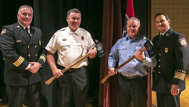 Outstanding Service Awards were presented to Murfreesoro Fire and Rescue's Robert Canterbury, second from left, and Douglas Inglish third from left. Also pictured are Deputy Chief Roger Toombs,left,  and Fire Rescue Chief Mark Foulks, right.