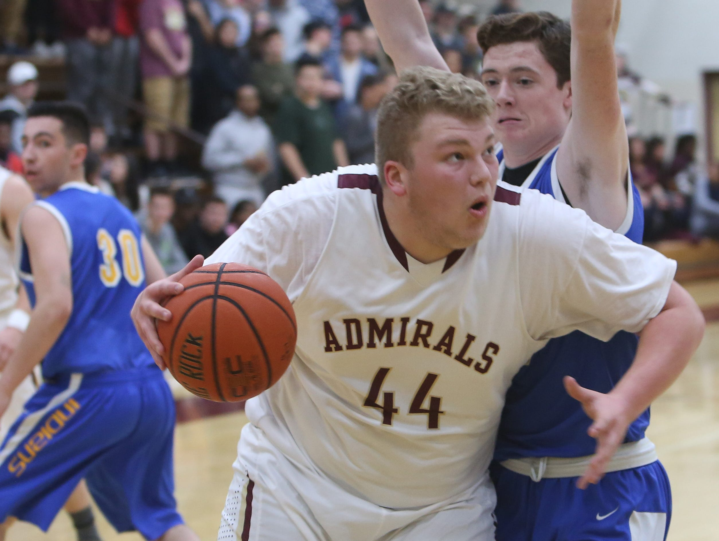 Arlington's Shane Wokzyk (44) drives to the basket in front of Mahopac's Ryan Dugan (23) during a boys basketball game at Arlington High School Jan. 12, 2017.