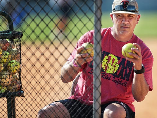 Tipton Rosemark Academy Coach Johnie Sanfratello conducts batting practice Wednesday. The Rebels are a legitimate title contender in a sport Memphis typically doesn't have a lot of success in.