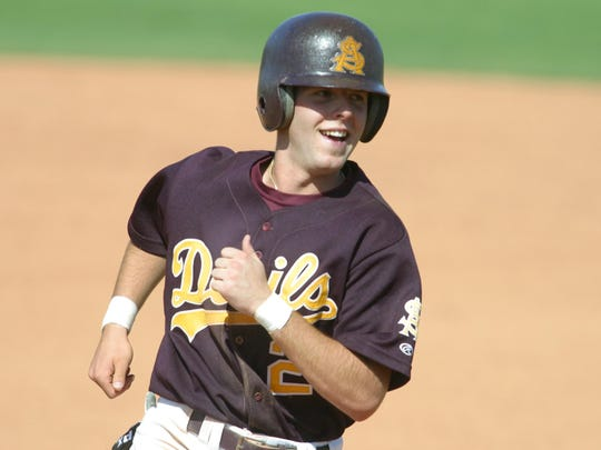 ASU infielder Dustin Pedroia smiles as he runs home 7a3e10904f0