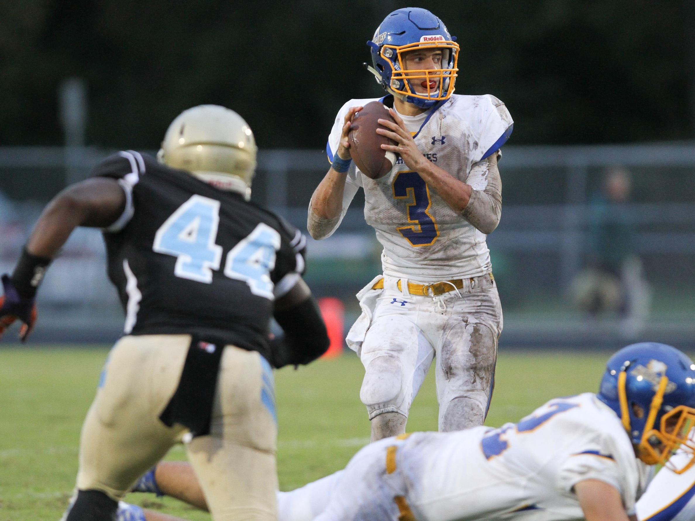Wren quarterback Jay Urich (3) looks to pass against Daniel friday night at Daniel High School, October 2, 2015.