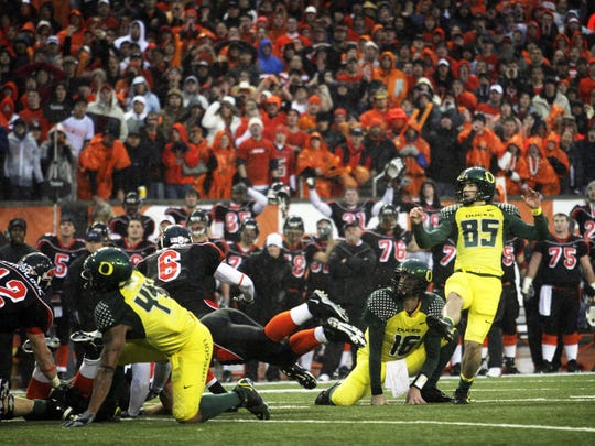 Matt Evensen watches as his field goal attempt is blocked, cementing the Ducks' loss. Oregon State beats Oregon in the annual Civil War battle, taking place this year at Reser Stadium in Corvallis. Photographed Nov. 24, 2006.