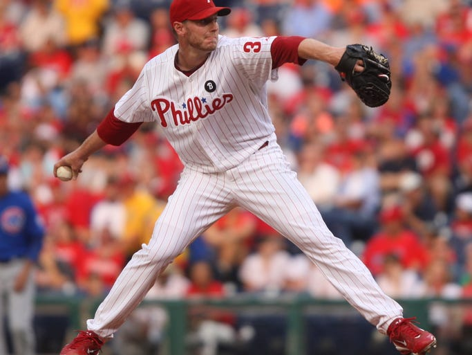 Phillies starter Roy Halladay throws in the first inning
