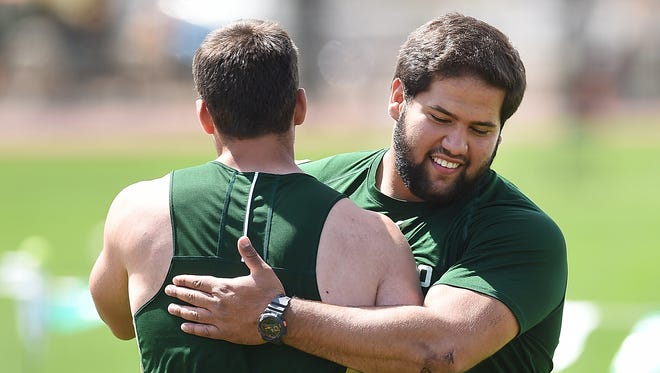 CSU shot put thrower Mostafa Hassan, right, qualified for the NCAA Outdoor Track & Field Championships on Saturday.