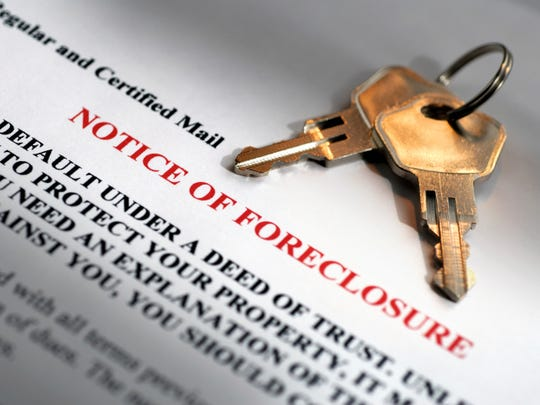 Notice of foreclosure and house keys.