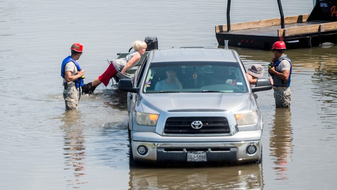 A family is rescued from their car Friday in Port Arthur, Texas in the aftermath of Hurricane Harvey.
