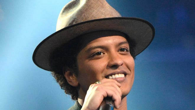 """Bruno Mars accepts the Best Male Video award for """"Locked Out of Heaven"""" during the 2013 MTV Video Music Awards at the Barclays Center on August 25, 2013 in the Brooklyn borough of New York City."""