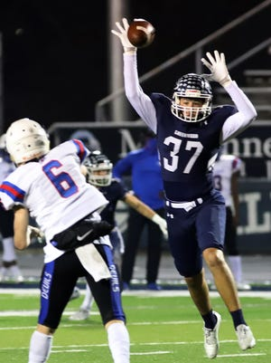 Greenwood's Colt Owenby bats down the pass attempt by West Memphis' Caden Smith in the first quarter, Friday, Nov. 13, at Smith Robinson Stadium.