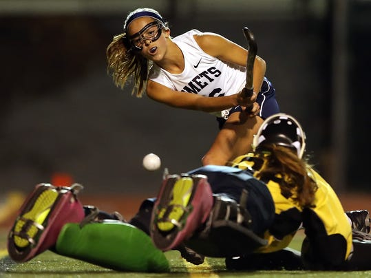 Penn Manor's Emma DeBerdine (16) shoots and scores on Hershey goalie Katharine Olmstead (86) during first half action of a District 3 3A field hockey semifinal at Milton Hershey School Wednesday November 4, 2015. Chris Knight - GametimePa.com