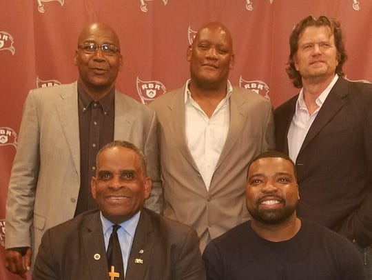 Eric McCoo (bottom row, right) is part of a group inducted into the Red Bank Regional Hall of Fame last year, including former NFL players: (top row, left to right) John Lee, Danny Stubbs, Greg Montgomery; (bottom row) Lonnie Algood.