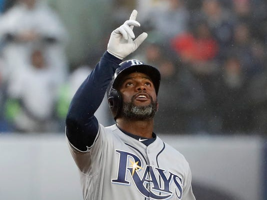 Tampa Bay Rays' Denard Span points skyward after hitting a sixth-inning, two-run double off New York Yankees relief pitcher Tommy Kahnle in a baseball game at Yankee Stadium in New York, Tuesday, April 3, 2018. (AP Photo/Kathy Willens)