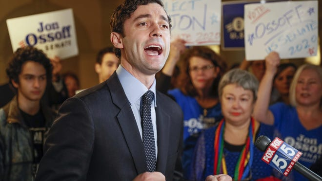 FILE - In this March 4, 2020, file photo, Jon Ossoff speaks to the the media and supporters after he qualified to run in the Senate race against Republican Sen. David Perdue in Atlanta. Republican Sen. David Perdue of Georgia is set to face Democrat Jon Ossoff in the first debate of their U.S. Senate race Monday afternoon, Oct. 12, 2020.