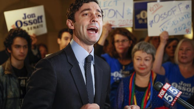 Jon Ossoff speaks to the the media and supporters after he qualified to run in the Senate race against Republican Sen. David Perdue.