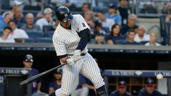 New York Yankees' Alex Rodriguez swings on an RBI single during the third inning of a baseball game against the Minnesota Twins on Friday, June 24, 2016, in New York.